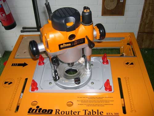 Triton 2000 series workcentre the advantage of the triton router is seen clearly in this picture above the table bit changes even with the routers own base plate still attached greentooth Choice Image